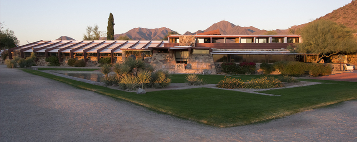 A house designed by Frank Lloid Wright. There are hills in the background.